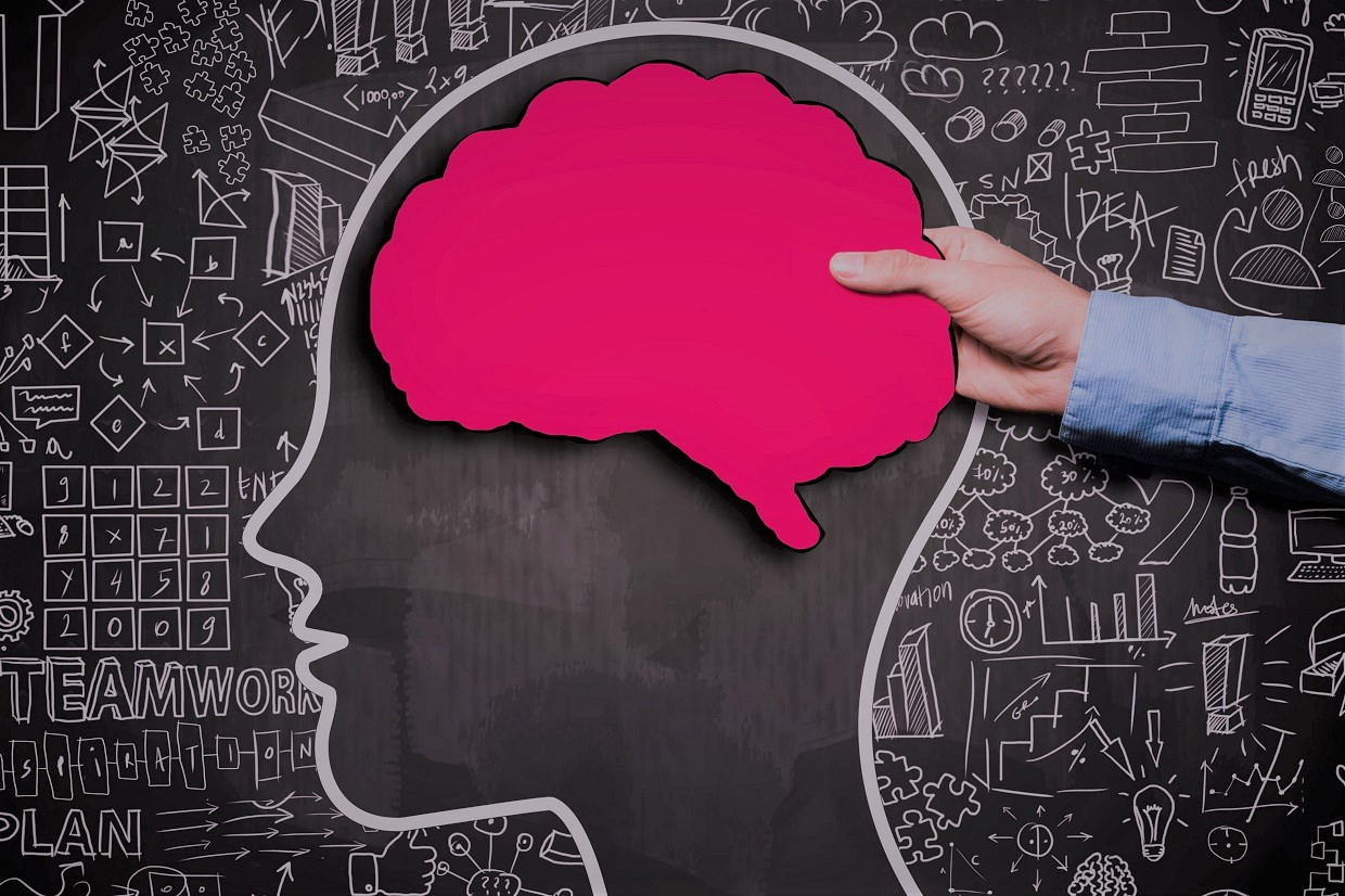 Businessman holding brain shape panel,  on blackboard with chaotic charts (Click for more)