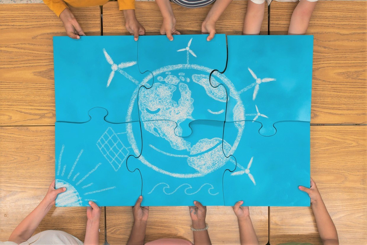Elementary students portraying a bright future of renewable energy